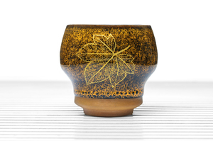 High Sided Footed Tea Bowl With Speckled Yellow And Brown Glaze And Golden Leaf Pattern